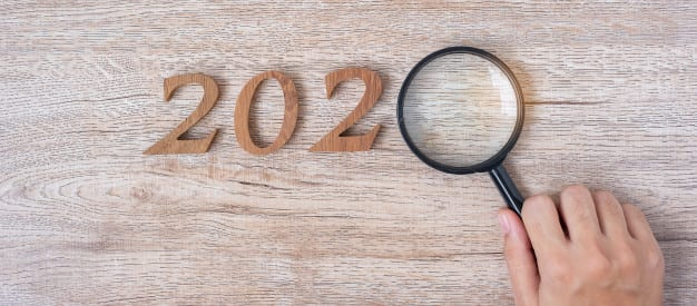 2020 local seo hand holding a magnifying glass
